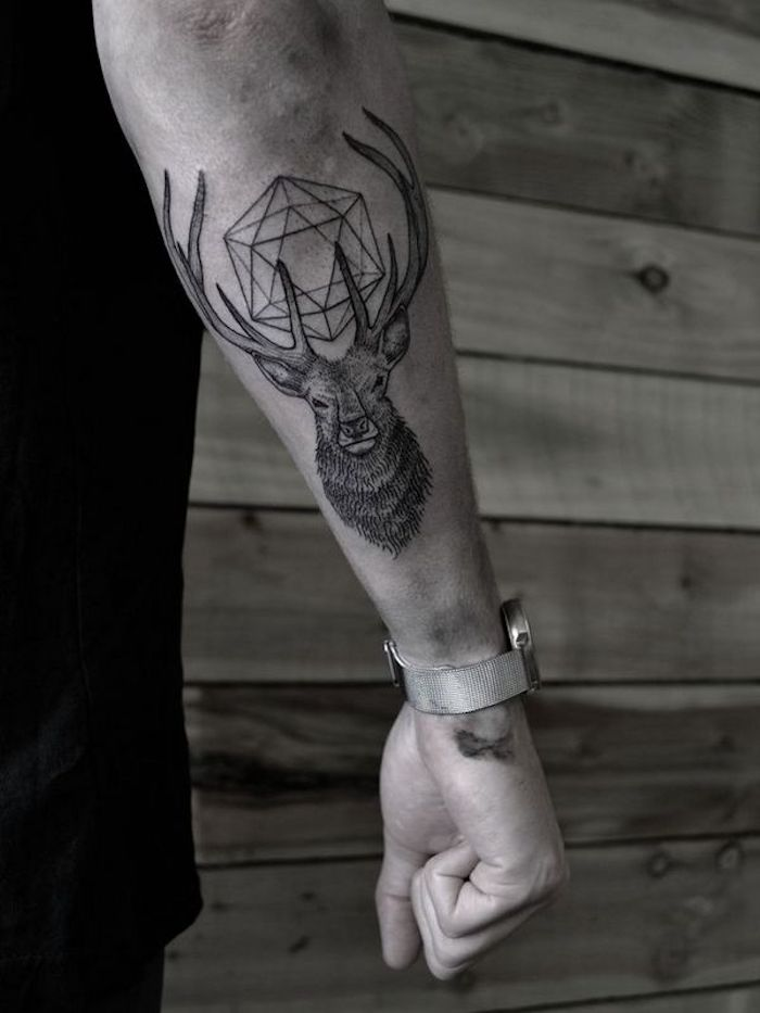 geometrical deer, forearm tattoo, wooden wall, cool simple tattoos, black shirt