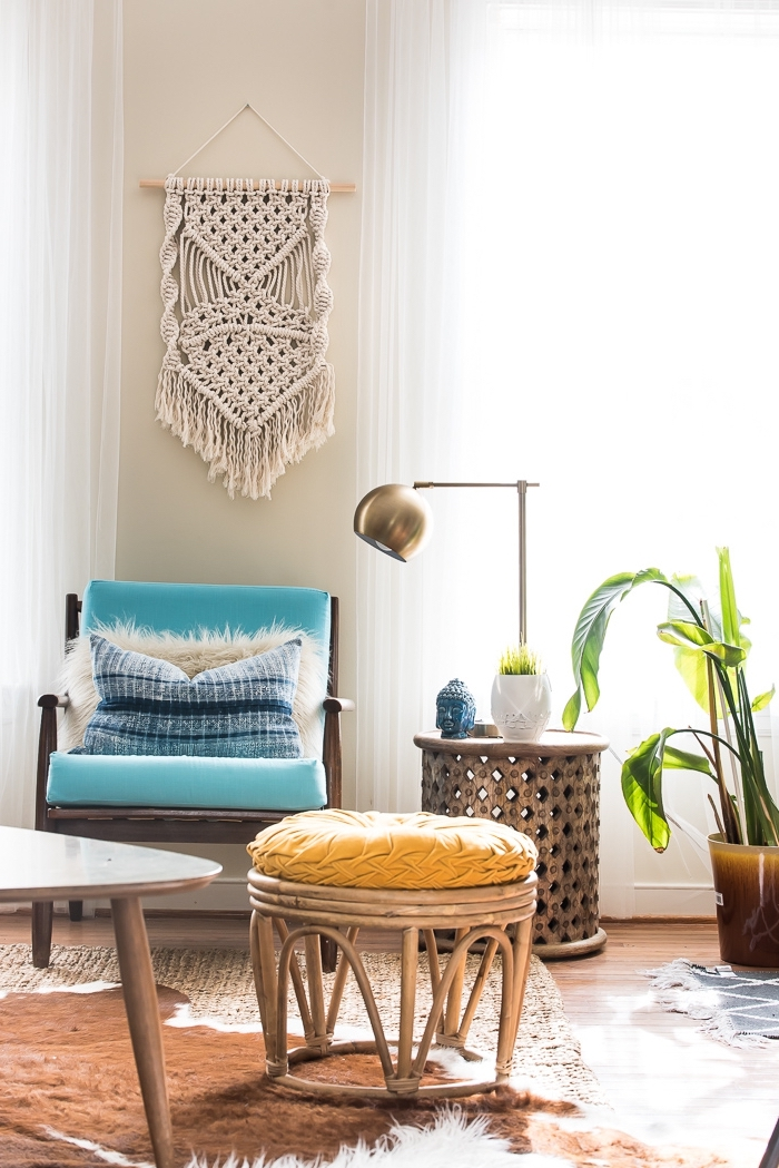 blue armchair, wooden ottoman, brass metal lamp, potted plants, learn macrame, blue throw pillow