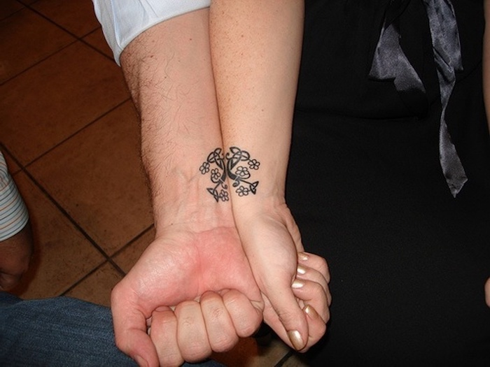 wrist tattoos, boyfriend and girlfriend matching tattoos, tiled floor