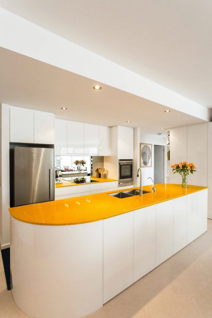 yellow countertops, white cabinets, pictures of kitchen islands, white tiled floor