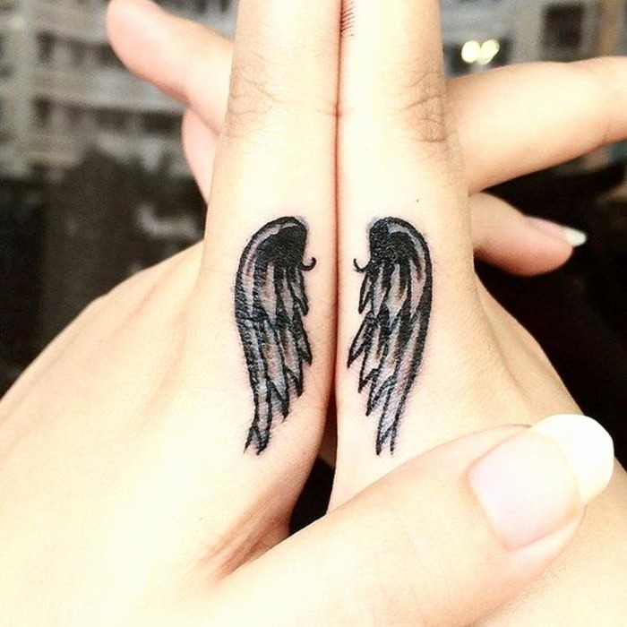 angel wings, finger tattoos, intertwined hands, matching bestfriend tattoos, long nails