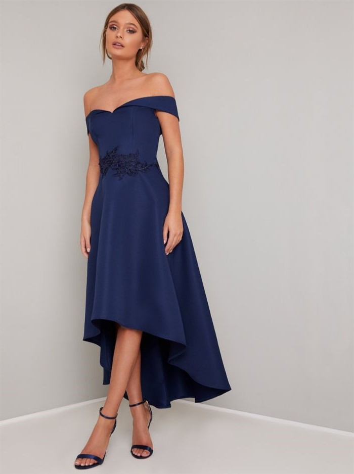 asymmetrical blue dress, mother of the bride dresses, blue sandals, blonde hair, low updo, off the shoulder neckline