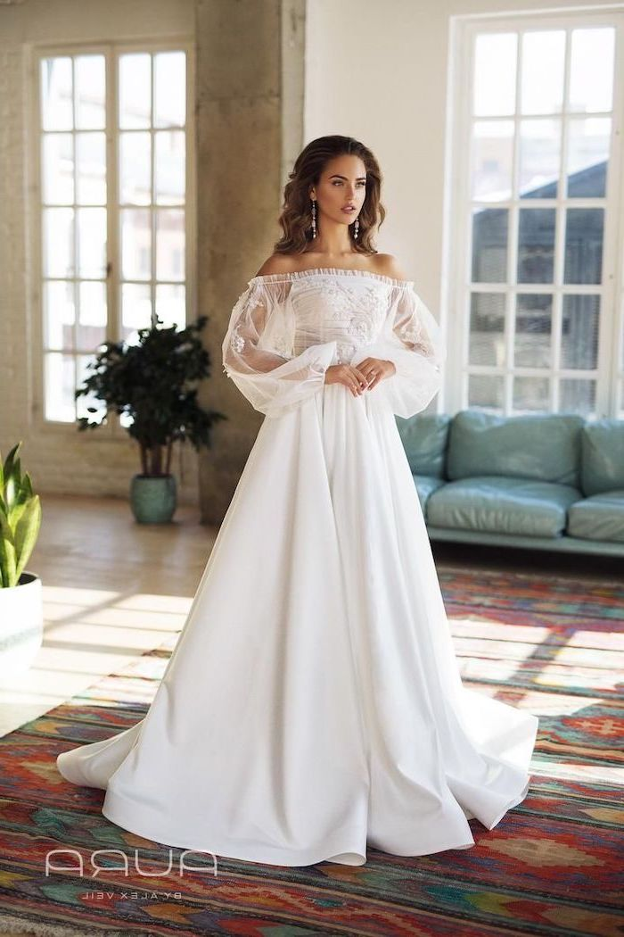 beaded wedding dresses, long brown wavy hair, lace and chiffon top, vintage rug