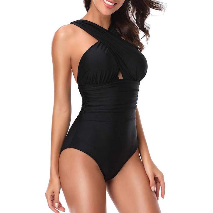 black one piece, toddler girls swimsuits, woman smiling, long brown wavy hair