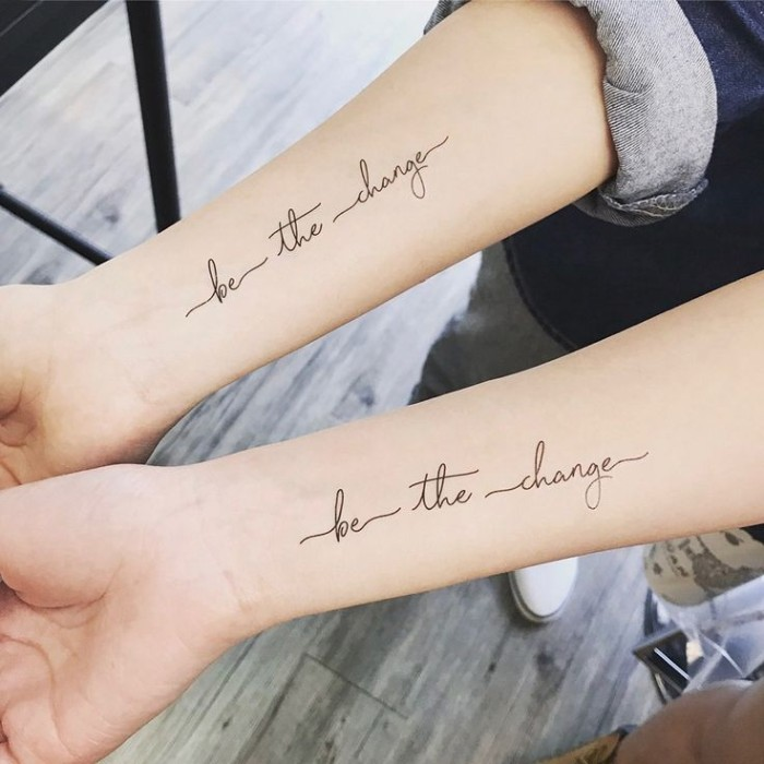 be the change, cursive font, forearm tattoos, wooden floor, matching tattoos
