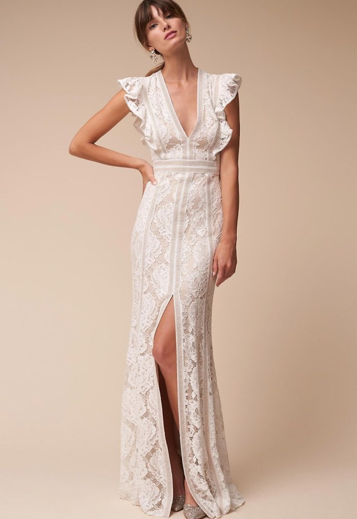 long lace dress, with a slit, wedding dresses for beach weddings, brown hair, in a ponytail, with bangs