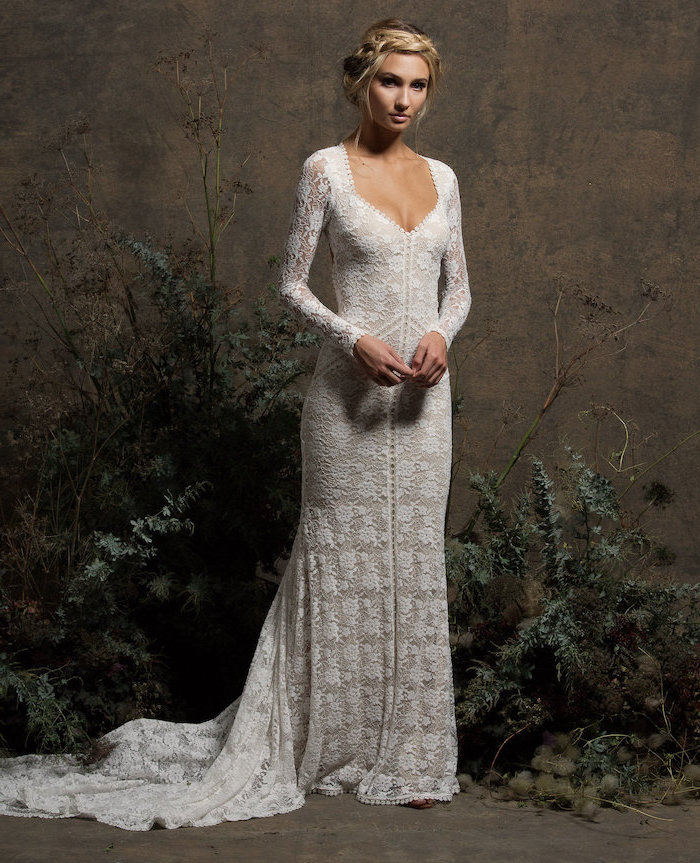 long lace dress, beaded wedding dresses, blonde braided hair, in a low updo, v neckline