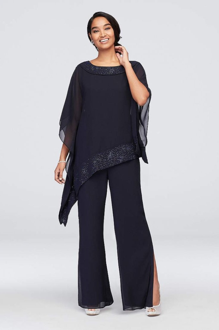 black chiffon, sequin lines, two piece suit, mother of the bride dresses, black hair, in a low updo, wide sleeves