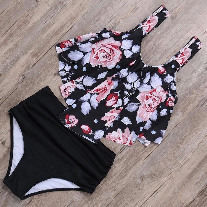 little girl swimsuits, black high waisted bottom, pleated floral top, wooden background