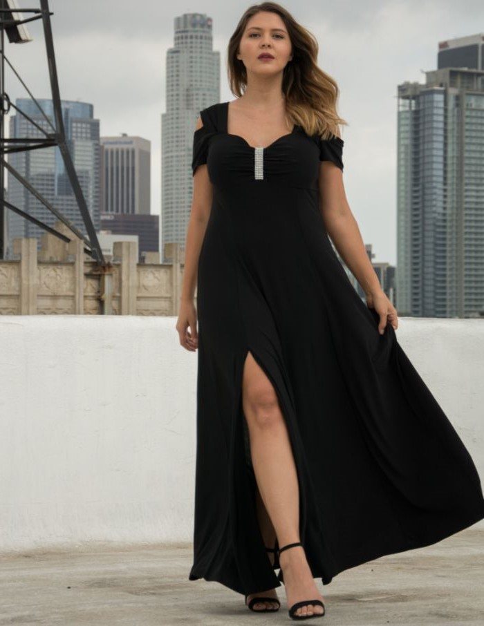 long black chiffon dress, off the shoulder neckline, mother of the bride gowns, black sandals, city landscape