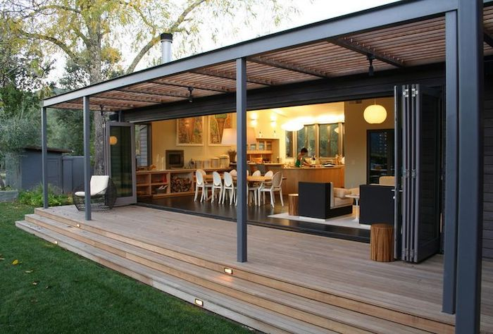 sliding doors, small black armchair, white cushions, front porch furniture, wooden staircase