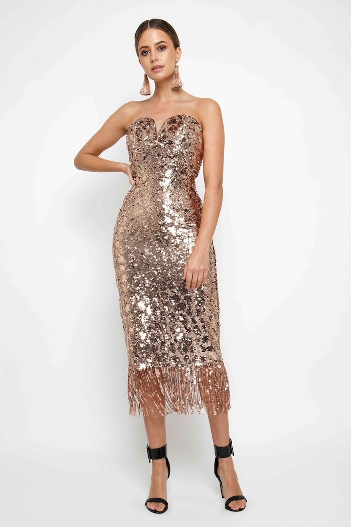 brown hair, in a low updo, black sandals, gold bridesmaid dresses, strapless sequinned dress