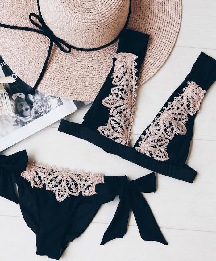 black two piece, with light pink lace, little girl swimsuits, wooden background, straw hat