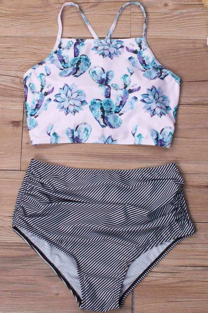 black and white striped, high waisted bottom, pink floral printed top, toddler bathing suits, wooden background