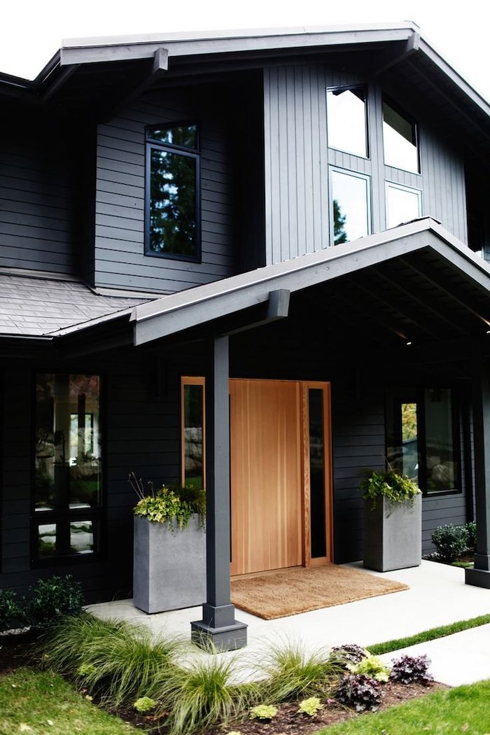dark wooden house, large door, metal columns, potted plants, front porch decorating ideas