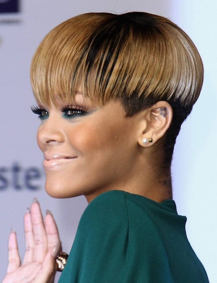 rihanna smiling, african american short hairstyles, wearing a green dress, with blonde hair