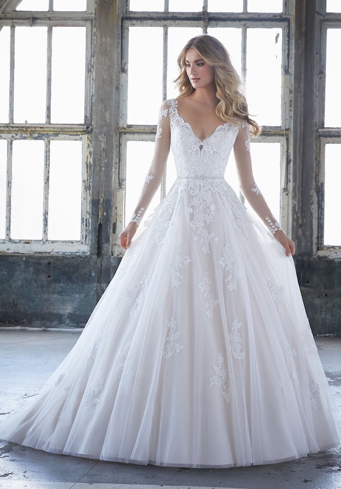 large white dresses, made of lace and tulle, blonde long wavy hair, long sleeve wedding dresses
