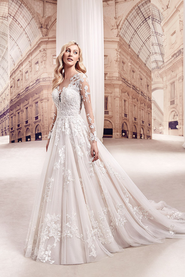 long white dress, made of chiffon and lace, long blonde wavy hair, long lace sleeves, beaded wedding dresses