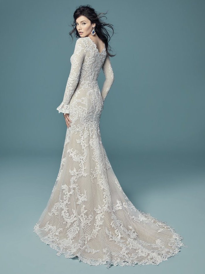 long black wavy hair, long sleeve lace wedding dress, blue background