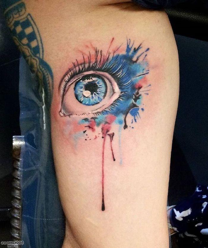 blue eye, delicate flower tattoos, watercolor inside arm tattoo