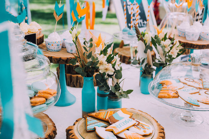 orange and blue, rustic decor, wooden cake stands, macaroons in a jar, flower bouquets, birthday party themes