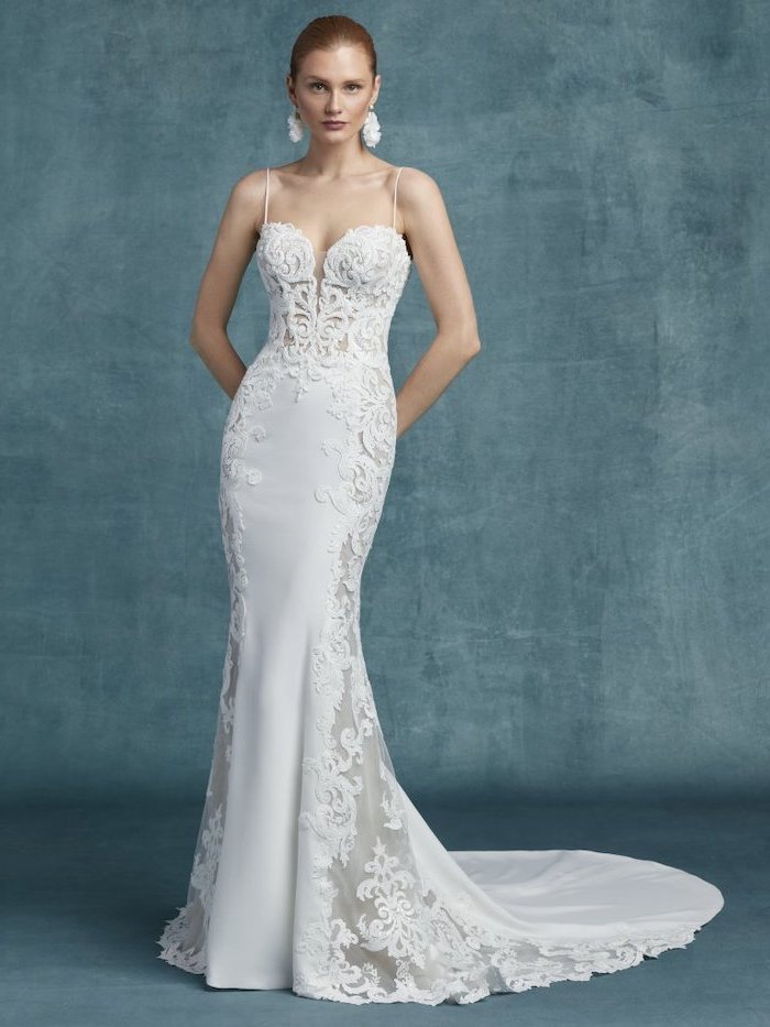 boho beach wedding dress, made of satin and lace, sweetheart neckline, blonde hair, in a low updo