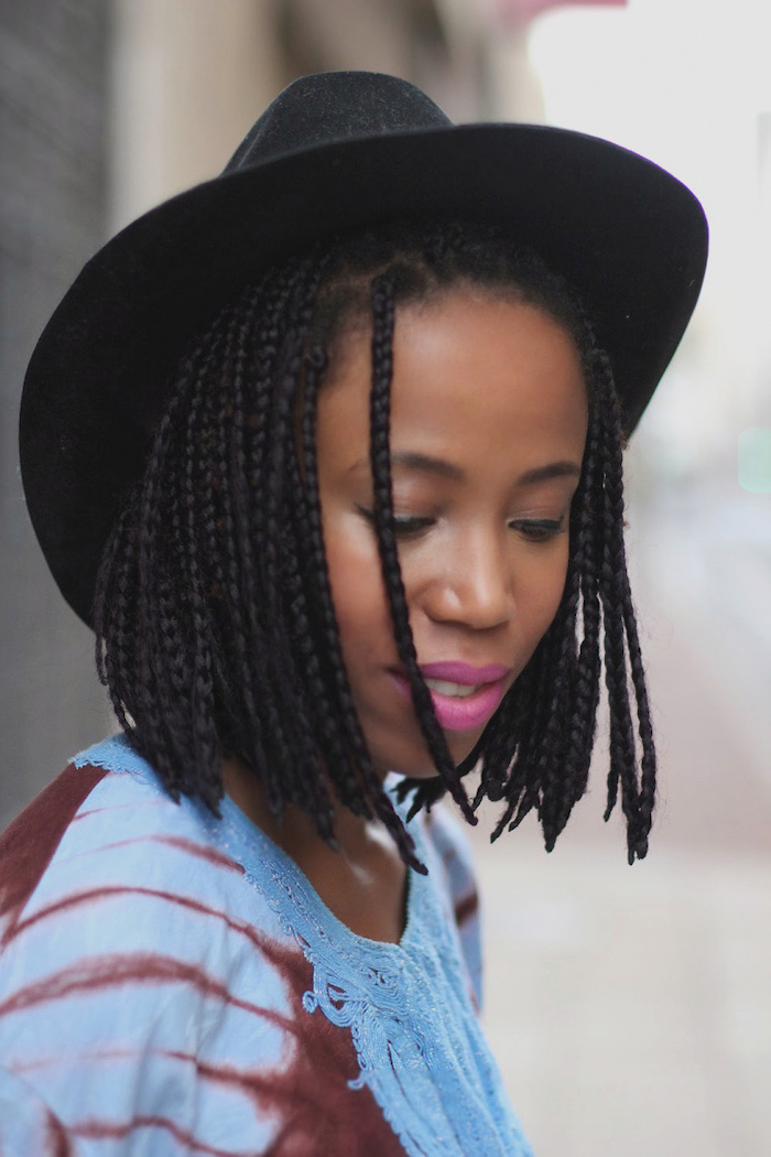 black hat, braided short hair, short haircuts for black women, pink lipstick, blue top