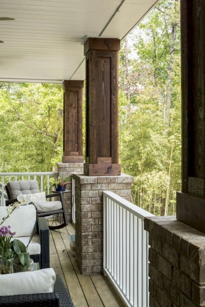brick and wood columns, wooden railing, front porch decorating ideas, garden furniture, grey cushions