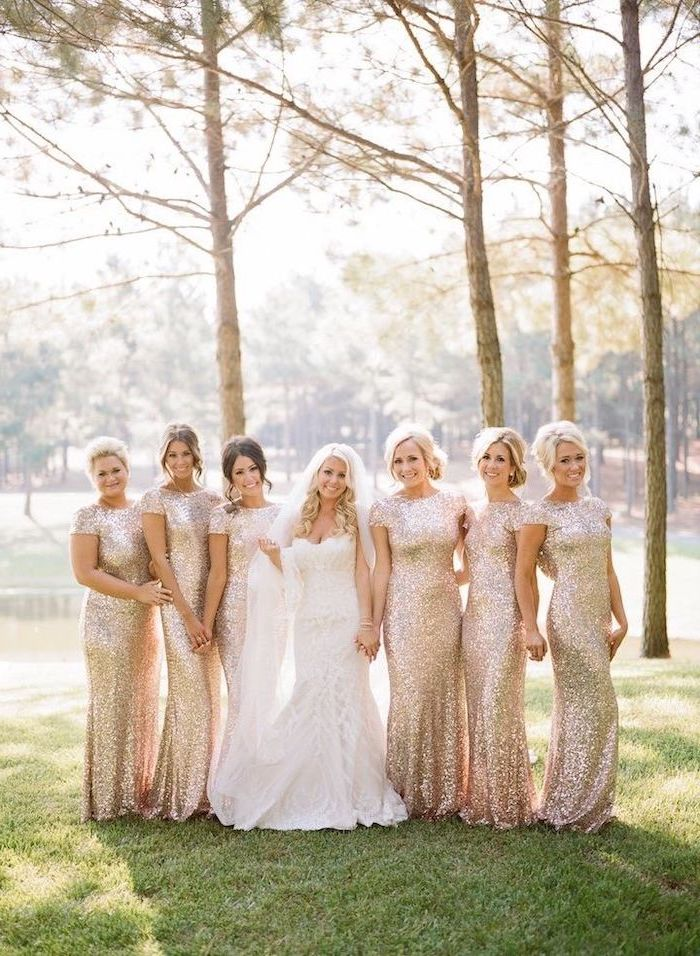 bride in the middle, rose gold sequin bridesmaid dresses, forest landscape