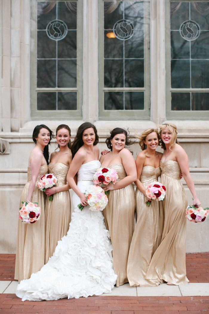 bride in the middle, gold strapless dresses, rose gold bridesmaid dresses, colourful flower bouquet