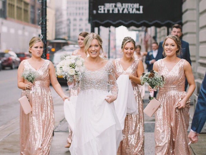 white flower bouquets, bride in the middle, rose gold sequin bridesmaid dresses