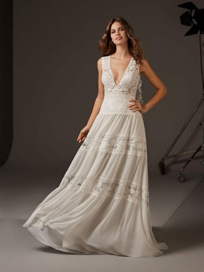 long brown wavy hair, boho beach wedding dress, made of lace and chiffon, plunging v neckline