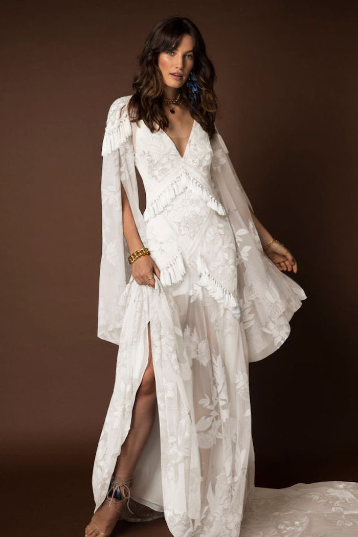 wide sleeves, long white lace dress, brown wavy hair, with bangs, fitted wedding dresses