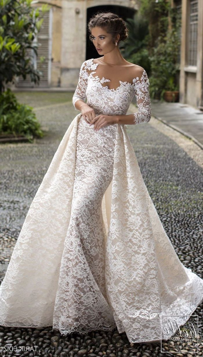 flowy wedding dress, braided brown hair, in a low updo, lace dress, lace train, off shoulder, long sleeves