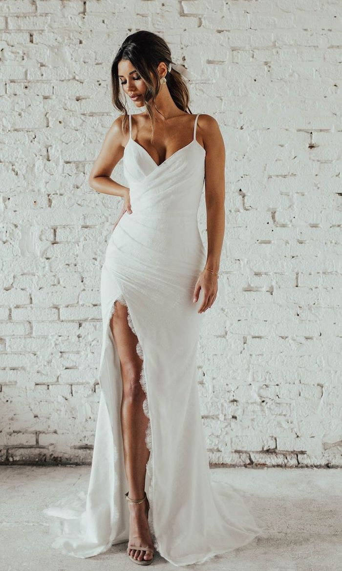 fit and flare, white dress with a slit, nude sandals, boho beach wedding dress, black hair, in a ponytail