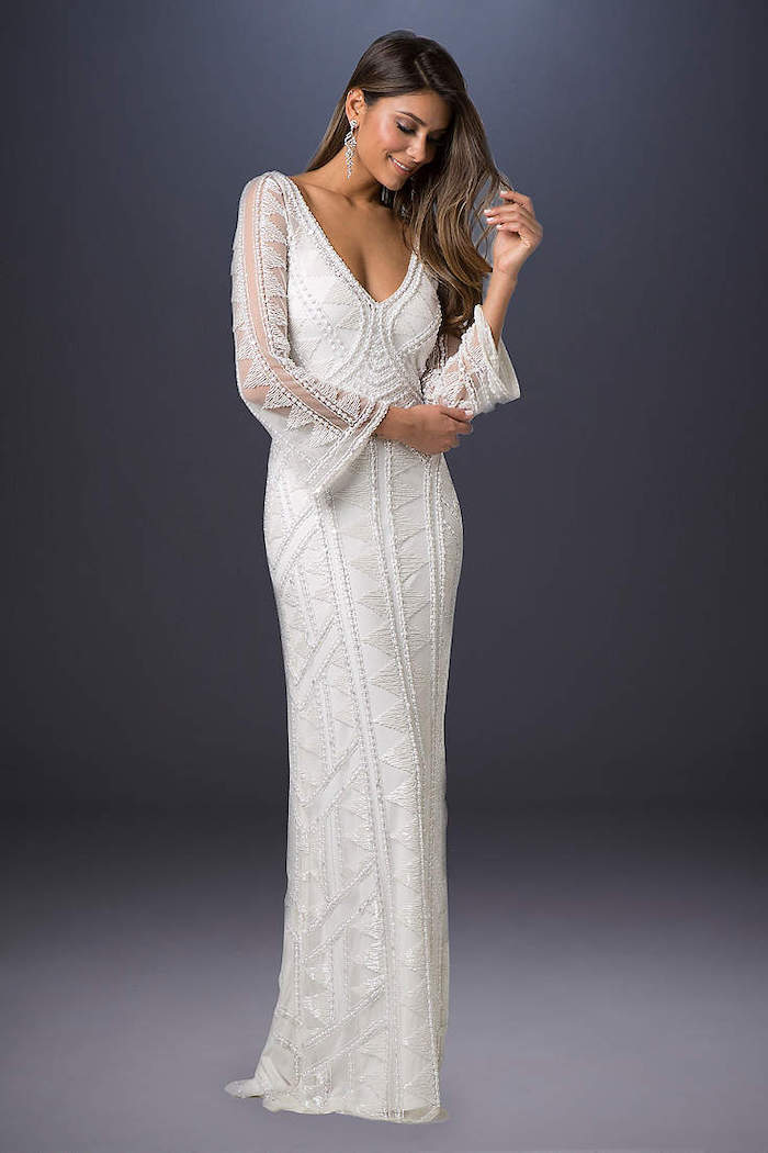 grey background, wedding dresses with sleeves, v neckline, long lace dress, long brown wavy hair