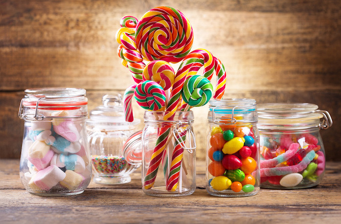 candy canes, gum balls, colourful sprinkles, in mason jars, birthday party themes, wooden background