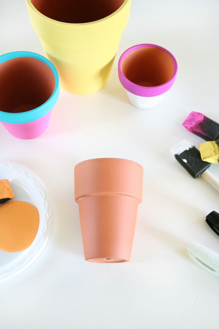 ceramic pots, painted in different colours, easy diys, white background