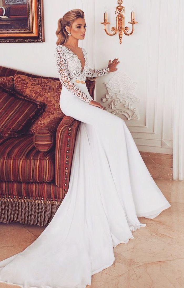 v neckline, lace top, long lace sleeves, blonde hair, in a high ponytail, long train, flowy wedding dress