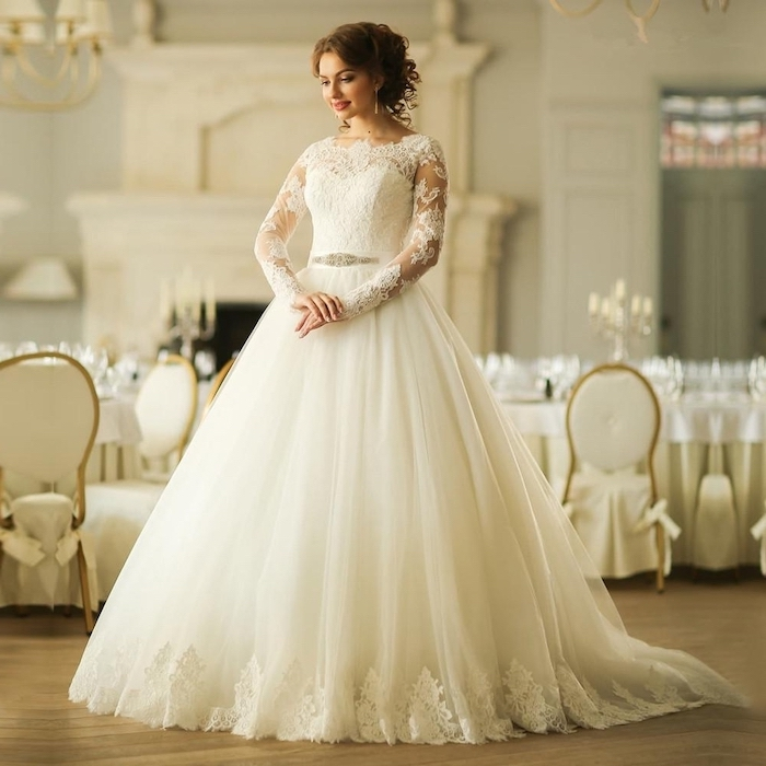 brown hair, in a high updo, flowy wedding dress, made of tulle and lace, wooden floor, lace sleeves