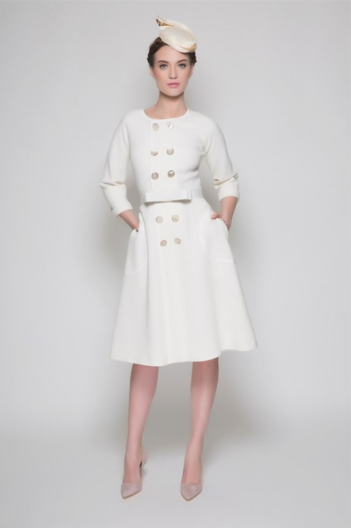 coat dress, in white, long sleeves, petite mother of the bride dresses, small hat, nude heels, brown hair, in a low updo