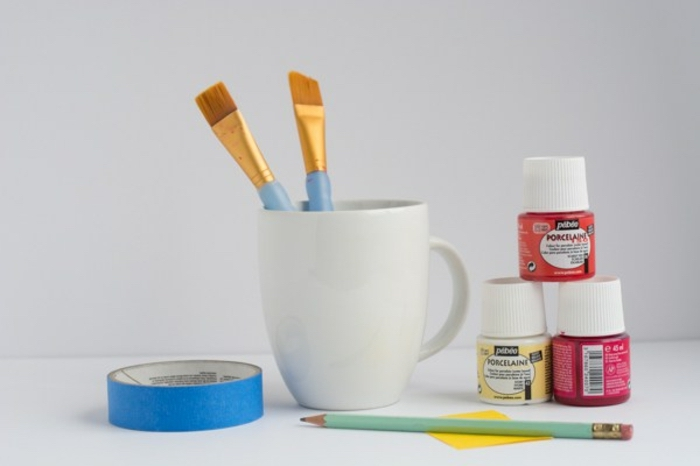 white coffee mug, duct tape, paint and brushes, crafts for adults, white background