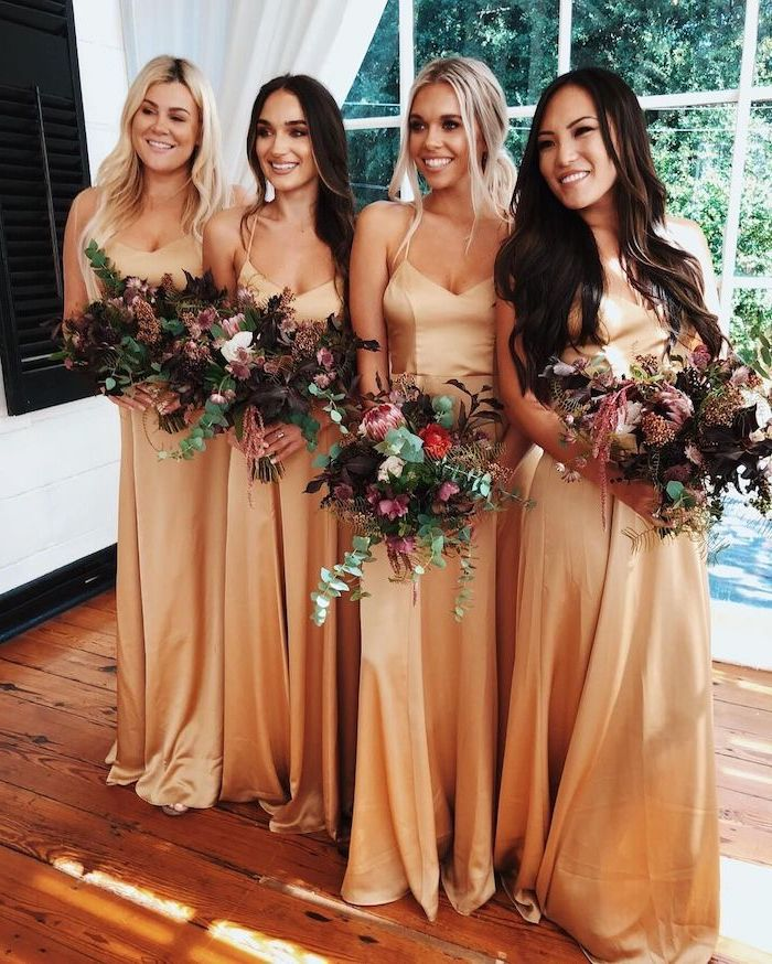 four women, in satin dresses, spaghetti straps, vintage bridesmaid dresses, colourful flower bouquets