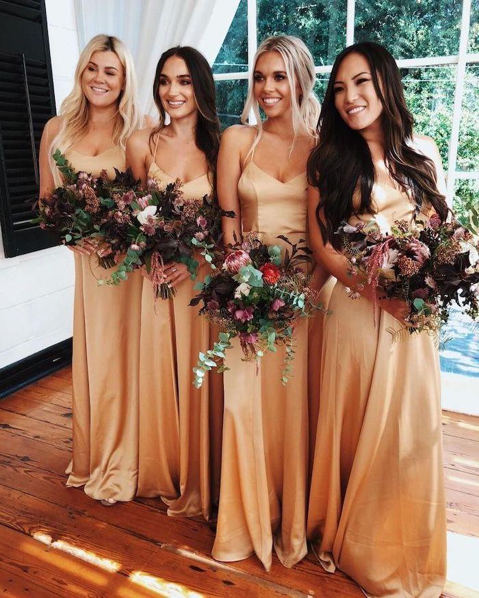 four women, in satin dresses, spaghetti straps, vintage bridesmaid dresses, colourful flower bouquets
