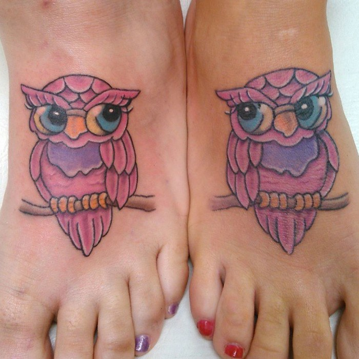 matching friend tattoos, pink owls, on tree branches, leg tattoos, red and purple nail polish
