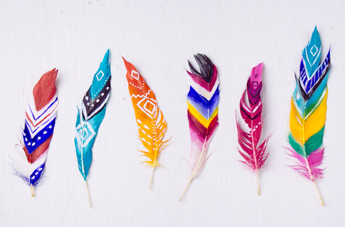 colourful feathers, painted in different colours, arts and crafts for toddlers, white background