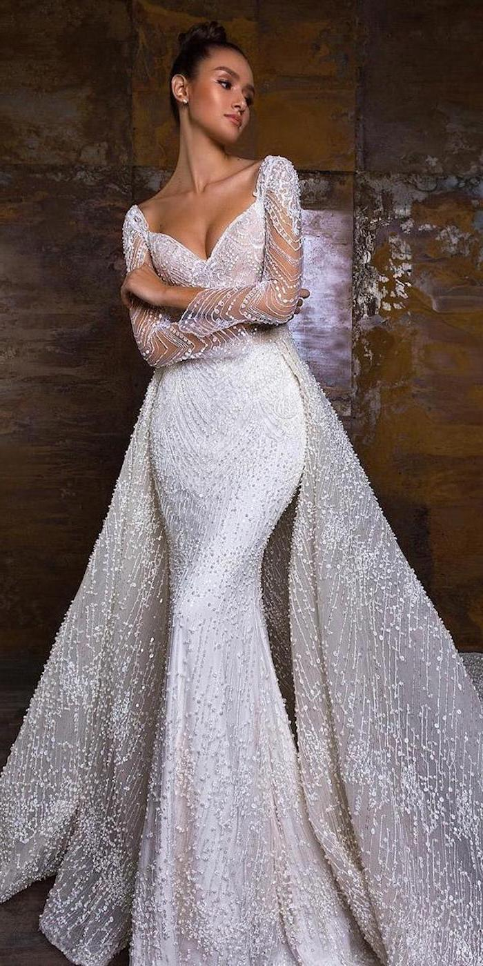 crystals on tulle, long sleeve lace mermaid wedding dress, brown hair, in a bun, v neckline