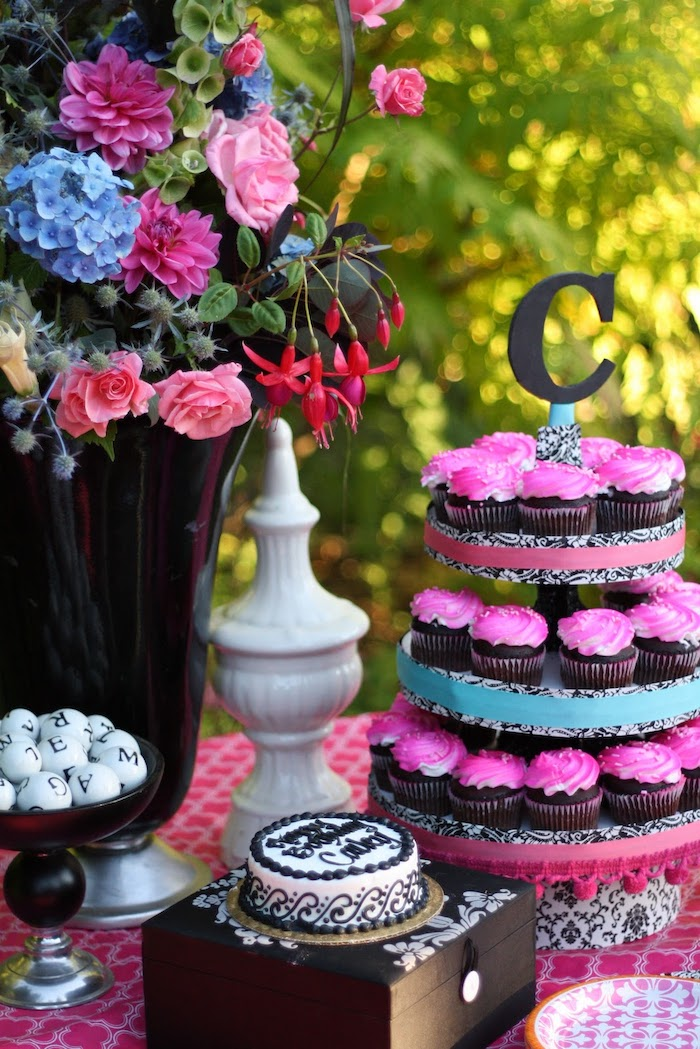 pink frosting, chocolate cupcakes, cupcake stand, colourful flower bouquet, fun games for teens