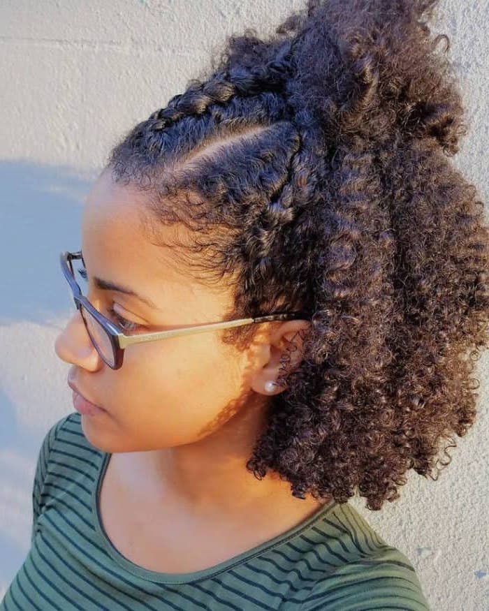 braided hair, in a ponytail, very curly, short hairstyles for black girls, green blouse