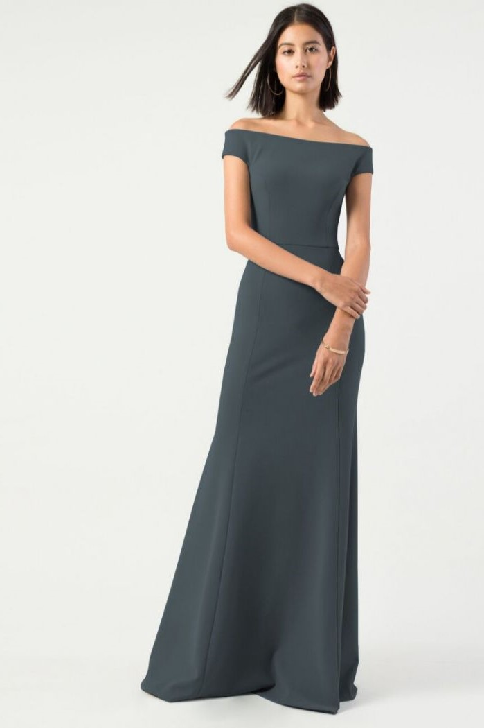 dark grey dress, off the shoulder neckline, short black hair, white background, petite mother of the bride dresses